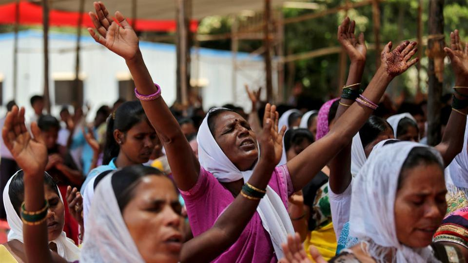 Women chant hymns during a sit-in rally in support of various demands including reservation in government jobs for Christians, in Mumbai on May 09, 2018. (Francis Mascarenhas / REUTERS)