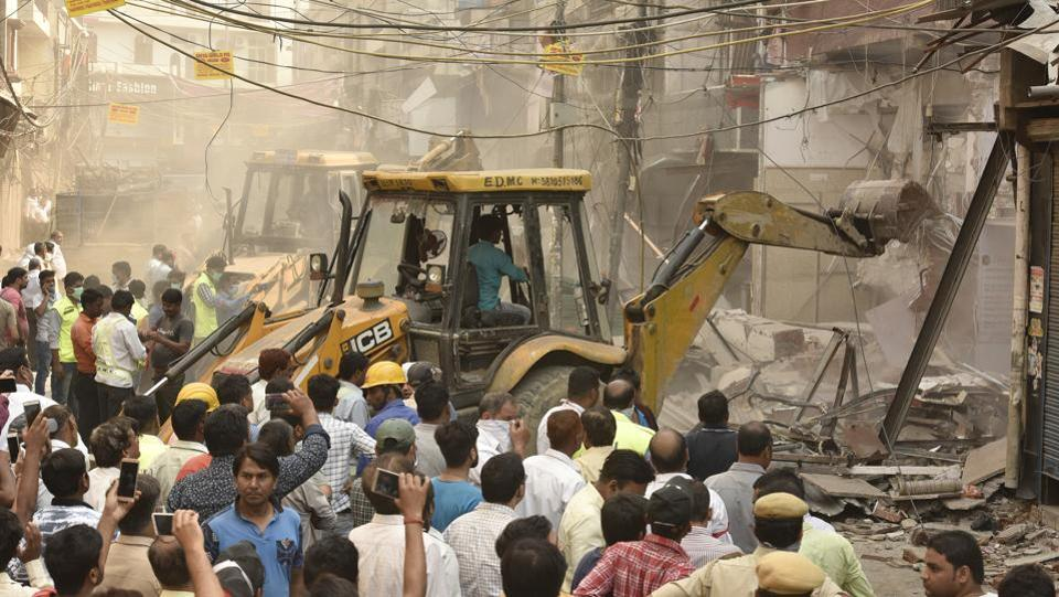 East Delhi Municipal Corporation (EDMC) officials demolish encroachments during an anti- encroachment drive at Mangal Bazar in Laxmi Nagar, New Delhi on May 10, 2018. (Raj K Raj  /HT Photo)