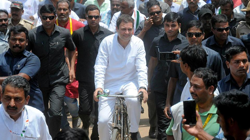 "All India Congress Committee (AICC) President Rahul Gandhi rides a bicycle during an election campaign for the forthcoming Karnataka assembly elections in Malur on May 7, 2018. Gandhi, during the rally, accused the BJP government of ""loot"" in the name of ""fuel"" by collecting Rs. 10 lakh crore in taxes on petrol, LPG and diesel, and not passing on the benefit of falling international crude price to the common people. (AFP)"