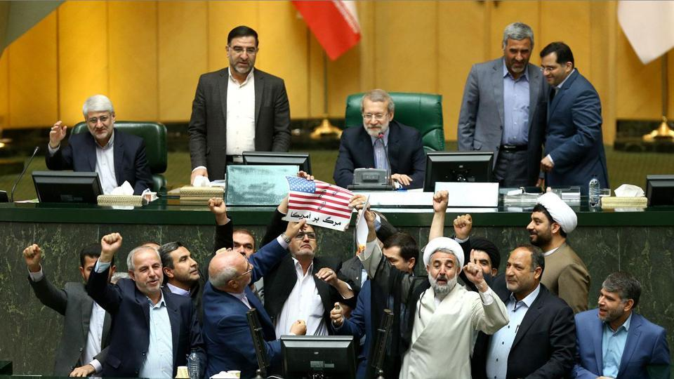"Iranian MPs prepare to burn a US flag in the parliament in Tehran after US President Donald Trump's decision to withdraw from the nuclear accord, which Iran branded ""psychological warfare."" (Islamic Consultative Assembly News Agency / AFP)"