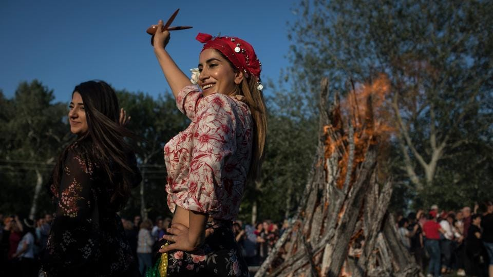 Women dance in front of a large bonfire during the Kakava Festival in Edirne, Turkey celebrating the coming of spring amongst the Roma community. (Chris McGrath / Getty Images)