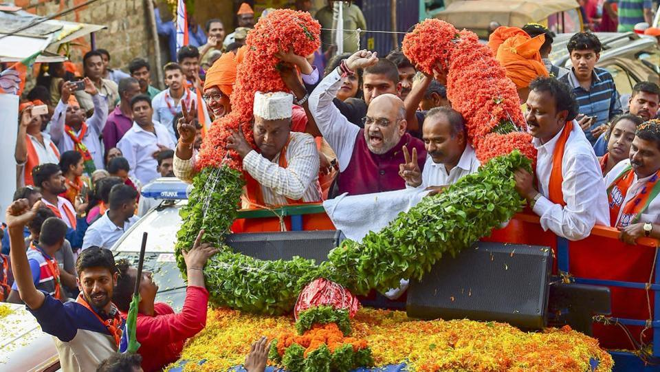 BJP National President Amit Shah campaigns in support of party candidate Katta Subramanya Naidu contesting from the Shivajinagar constituency during a road show ahead of the elections in Bengaluru on May 09, 2018. (PTI)