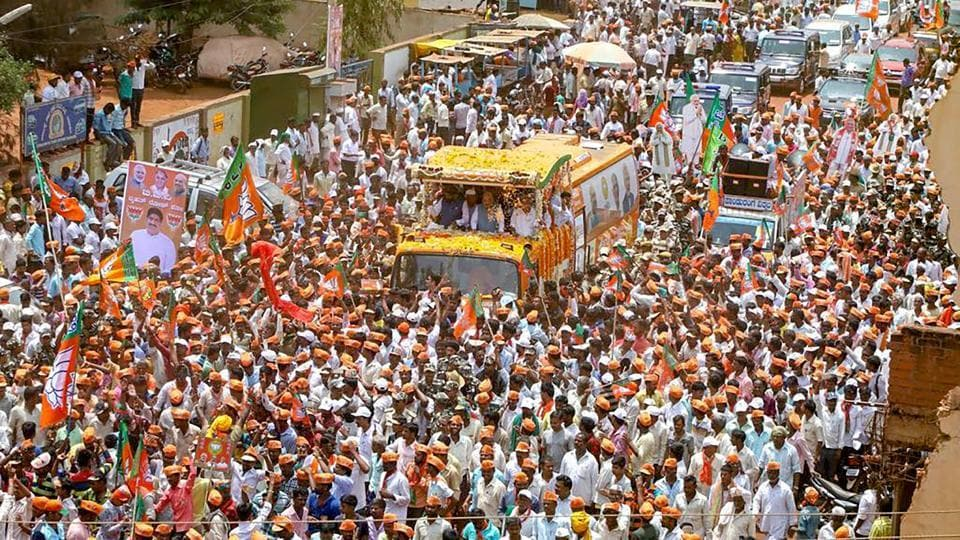 BJP President Amit Shah during a roadshow for an election campaign ahead of Karnataka Assembly elections in Badami on Thursday.
