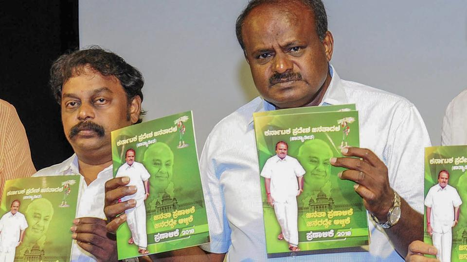 Janata Dal (Secular) President H D Kumaraswamy releases his party manifesto, in the presence of other party leaders, ahead of the Karnataka assembly elections 2018 in Bengaluru on May 07, 2018. (PTI)