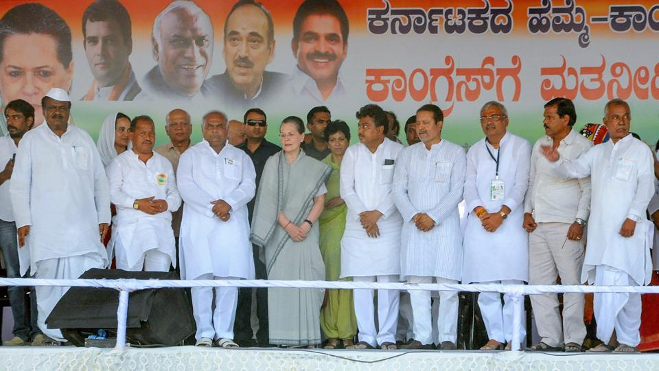 "UPA Chairperson Sonia Gandhi with Congress leaders during a public rally for an election campaign ahead  in Bijapur on May 08, 2018. Speaking at her first election rally in two years, UPA chairperson Gandhi  accused PM Modi of intolerance and discriminating against Congress-ruled Karnataka, questioning his promise of ""Sabka saath, sabka vikas."" (PTI)"
