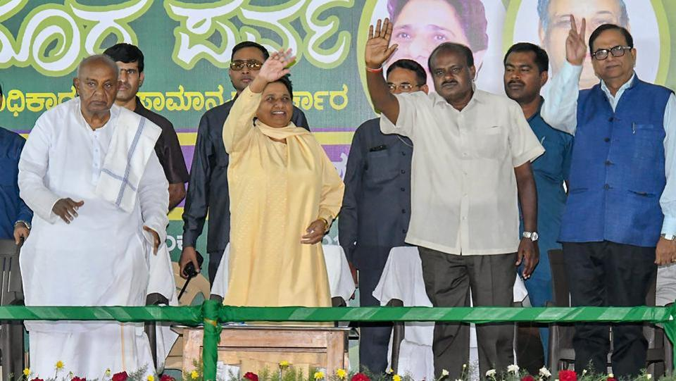 BSP chief Mayawati flanked by former Prime Minister HD Deve Gowda (L) and JD(S) state president HD Kumaraswamy (R) waves at her supporters during a campaign in Mysore on April 25, 2018. Addressing a rally, Mayawati, whose party has tied up with the Janata Dal (Secular), appealed to Dalits, Adivasis and Other Backward Classes in the state to not get swayed by the Congress and BJP as they were trying to put an end to reservations. (PTI)