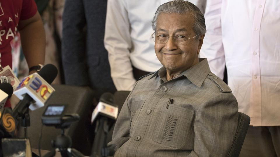 Mahathir Mohamad smiles during a press conference in Kuala Lumpur, Malaysia on May 10, 2018. Known as an authoritarian leader who persecuted his foes and stifled dissent, the pugnacious politician, remarkably robust at age 92, pulled off a stunning electoral upset on Wednesday, denying his former protege Najib Razak a third term as Prime Minister, ending the ruling National Front's 60-year hold on power. (Adrian Hoe / AP)