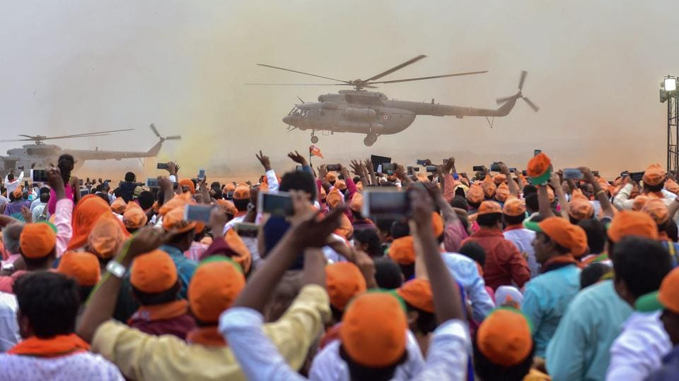 PM Narendra Modi arrives in a helicopter as BJP supporters cheer during a public rally ahead of the Karnataka assembly elections in Bengaluru on May 03, 2018. (PTI)