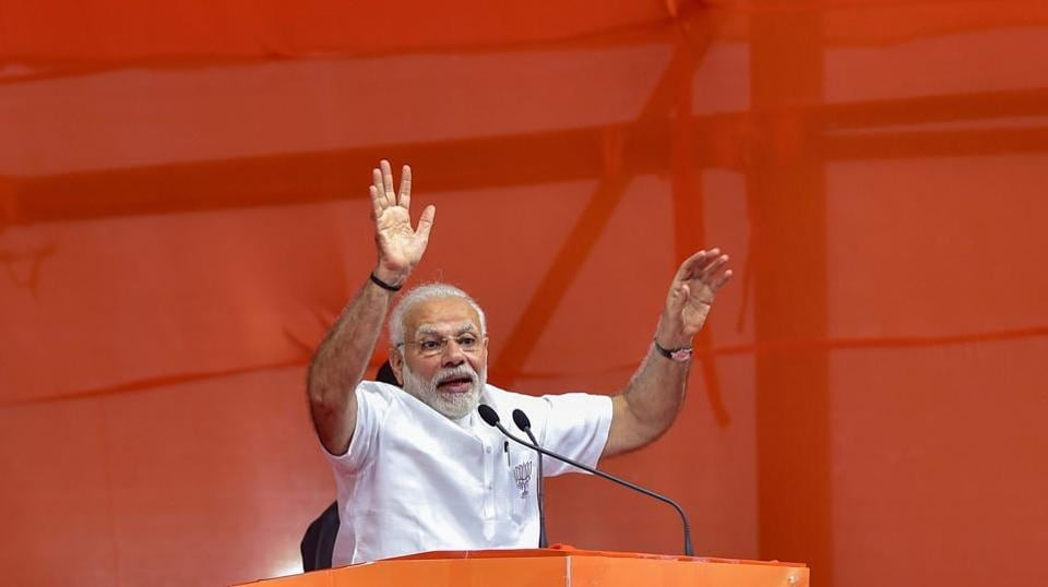 PM Narendra Modi addresses a public rally as part of the campaign strategy for the Karnataka assembly elections on May 03, 2018 in Bengaluru. Ahead of the Karnataka assembly elections on May 12, we take a look at the several road shows and rallies held by contesting candidates. (PTI)
