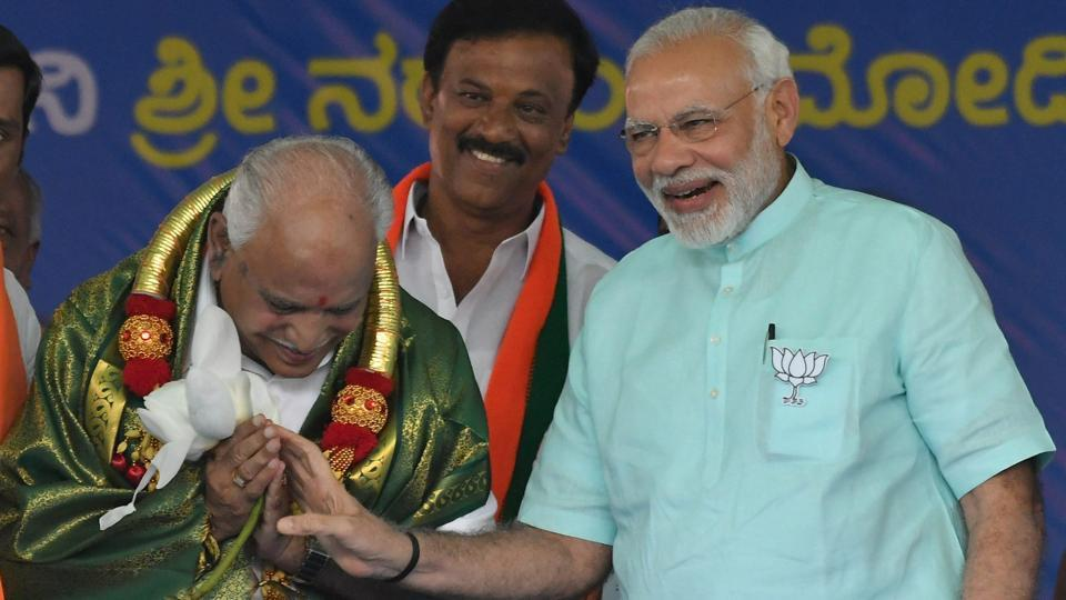 "Prime Minister Narendra Modi and BJP's chief ministerial candidate BS Yeddyurappa share a laugh during their Karnataka election campaign rally at Chamarajanagar on May 01, 2018. Speaking at the rally, Modi said, "" BS Yeddyurappa is the hope of the people of Karnataka and he is going to be the next chief minister of the state."" (PTI)"