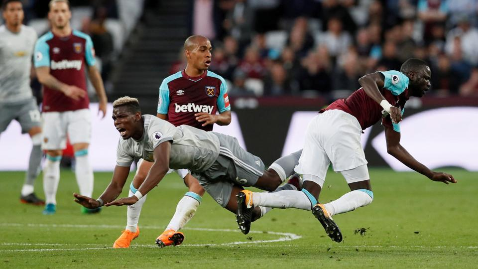 Manchester United's Paul Pogba (left) gets tackled by West Ham United's Cheikhou Kouyate during their Premier League match on Thursday.