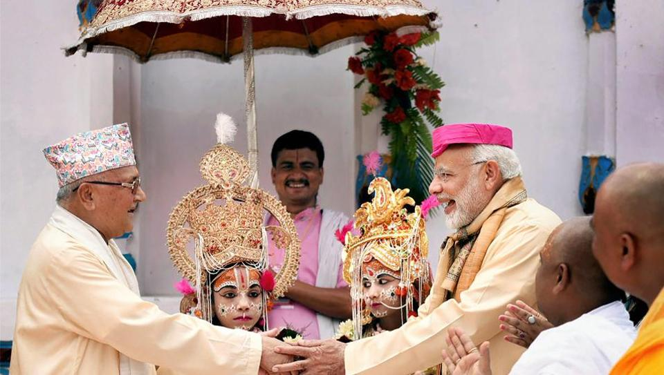Prime Minister Narendra Modi greets Nepalese Prime Minister Khadga Prasad Oli during his visit to the Janaki temple in Janakpur, Nepal on Friday. Nepal is at the top of India's Neighbourhood First policy, Modi said on Friday as he announced a grant of ₹100 crores to develop the sacred city of Janakpur and its surrounding areas. (PTI)