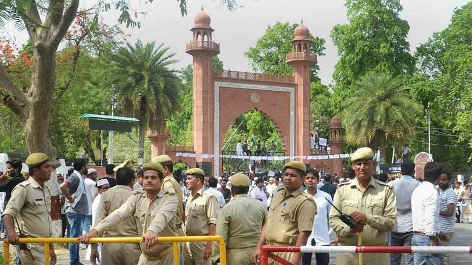 Security personnel stand guard as students stage a protest over Jinnah portrait issue outside the Aligarh Muslim University gate in Aligarh on May 4.
