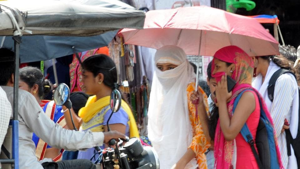 People try to protect themselves from the heat wave in Ranchi, on May 9.