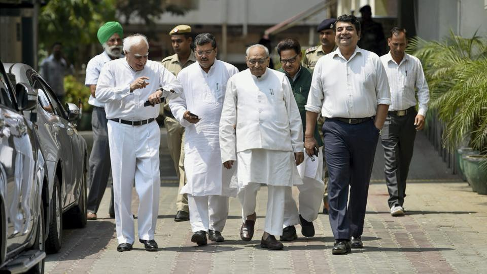Congress leaders Kapil Sibal, Motilal Vora, RPN Singh and others leave after a meeting with Election Commissioner of India at Nirvachan Sadan in New Delhi on Friday. The Congress on Friday petitioned the Election Commission demanding that BJP candidate B Sriramulu be disqualified from contesting the Karnataka assembly election over a 'sting' video allegedly showing him trying to a bribe a former chief justice of India's relative. (PTI)