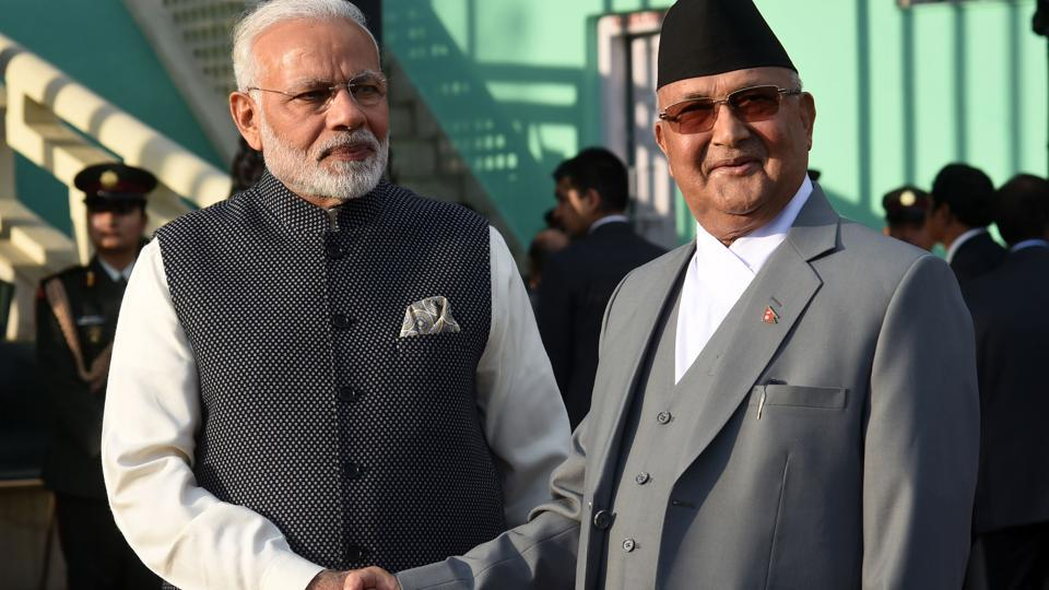 Nepali Prime Minister KP Sharma Oli  greets Prime Minister Narendra Modi during a guard of honour in Kathmandu on May 11, 2018.