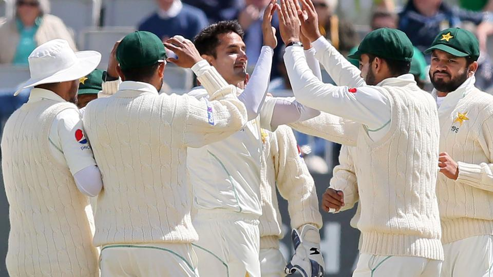 Pakistan's Mohammad Abbas (C) celebrates with teammates during their one-off Test match against Ireland on Sunday.