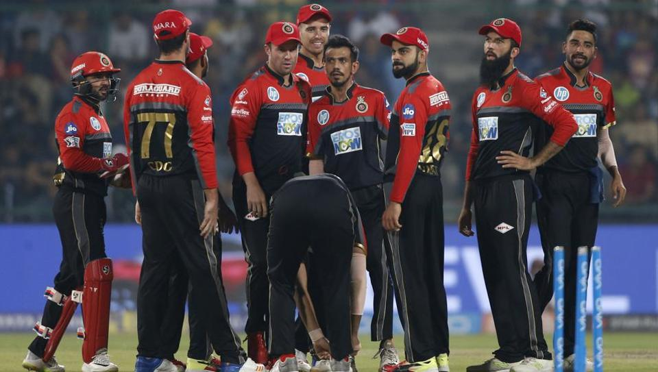 Cricketers from Royal Challengers Bangalore celebrate the dismissal of Delhi Daredevils' Prithvi Shaw during the IPL 2018 cricket match in New Delhi, India on May 12, 2018. RCB won by 5 wickets.  (AP)