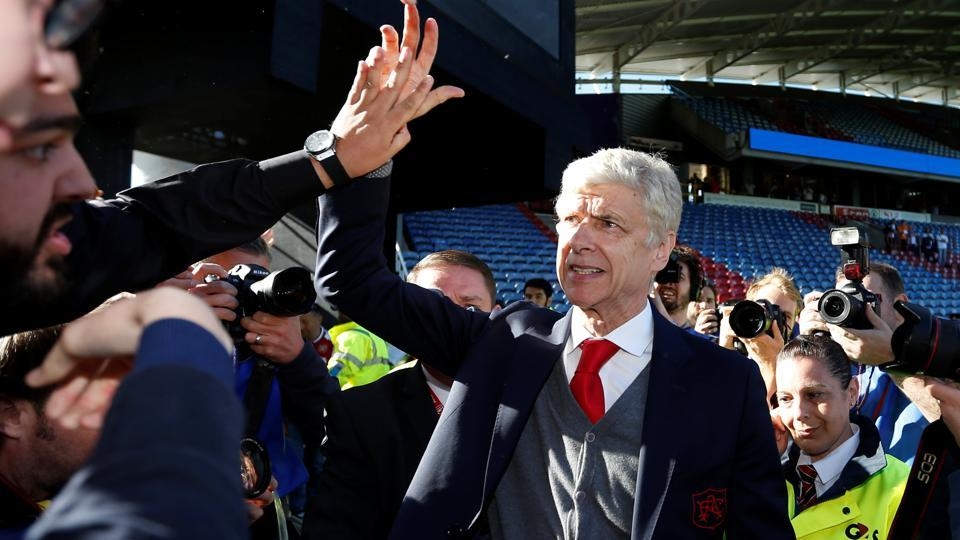 Arsenal manager Arsene Wenger waves to the fans at the end of their match against Huddersfield Town.