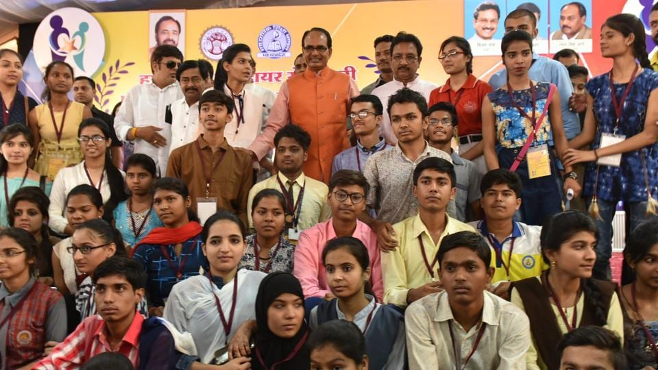 Meritorious students pose for a group picture with Madhya Pradesh chief minister Shivraj Singh Chouhan in Bhopal.