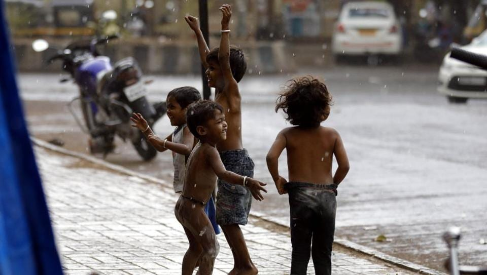 Childrens enjoying the light showers at KK market in Bibewadi on Sunday.