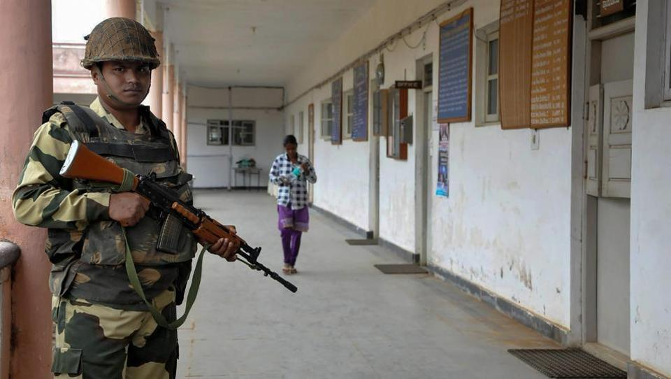 A securityman stands guard outside a room where Electronic Voting Machines (EVMs) are kept, at Chikmagalur in Karnataka on Monday. Results for Karnataka assembly elections will be declared on Tuesday.