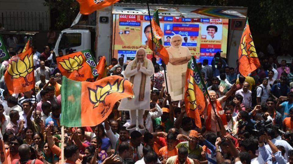 BJP supporters celebrate the party's performance in the Karnataka assembly elections, in Bengaluru on Tuesday.