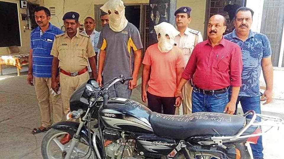The accused and the recovered stolen bike in police custody in Karnal on Sunday.