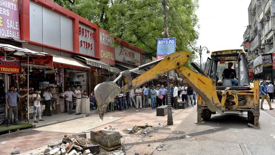 Municipal Corporation of Delhi (MCD) officials today, carried out demolitions against encroachments during an anti-encroachment drive at Karol Bagh in New Delhi. (Sanchit Khanna / HT Photo)