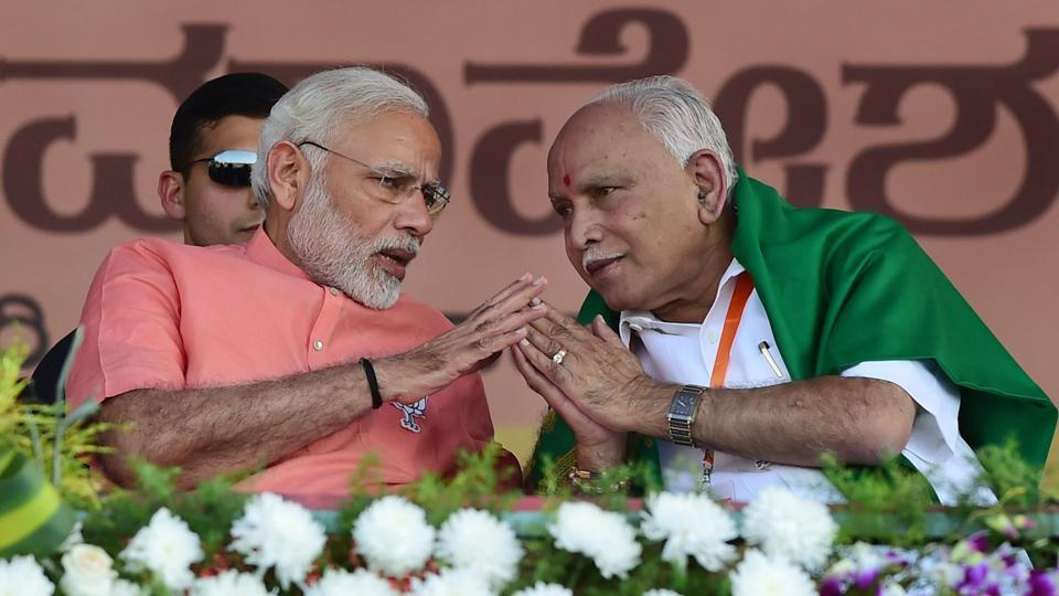 Prime Minister Narendra Modi with Karnataka BJP president and chief ministerial candidate BS Yeddyurappa at a campaign rally in Davanagere, Karnataka.