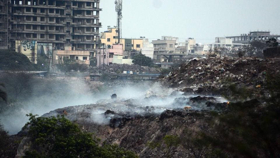 Garbage being burnt near Kharadi lake with the smoke adding  to the increasing levels of air pollution.