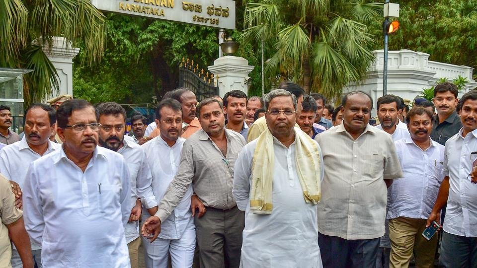 Outgoing Karnataka chief minister Siddaramaiah, JD(S) President H D Kumaraswamy with other leaders leave after meeting with Karnataka governor in Bengaluru.