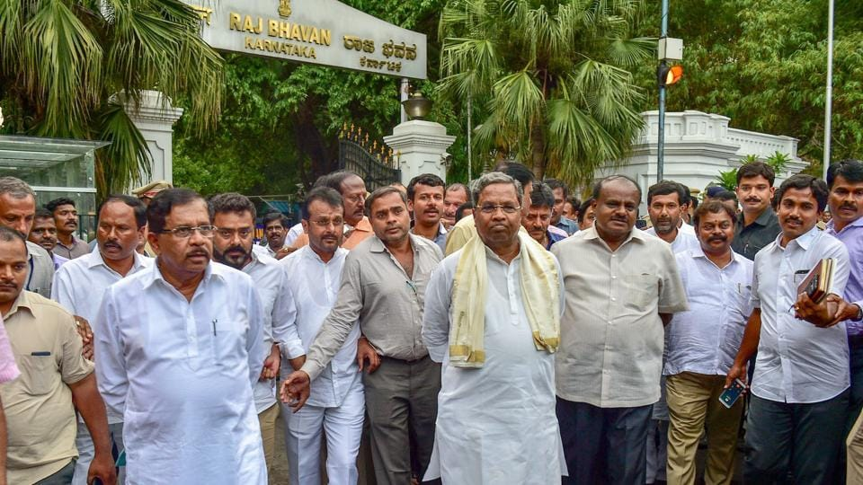 Outgoing Karnataka chief minister Siddaramaiah, JD(S) president HD Kumaraswamy with other leaders leave after a meeting with Governor Rudabhai Vajubhai Vala as Congress extends party support to JD(S) to form the new government after Karnataka Assembly Election results 2018 in Bengaluru on Tuesday.