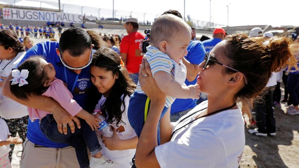 """Marcelino Pizarro hugged his family members for three minutes seeing them for the first time since he jumped the fence into the United States from Mexico six years ago. The undocumented migrant was at an event with hundreds of other families with mixed immigration status who were reunited with relatives in a """"hugs not walls"""" meeting arranged by Texas-based advocacy group, Border Network for Human Rights. (Lucas Jackson / REUTERS )"""