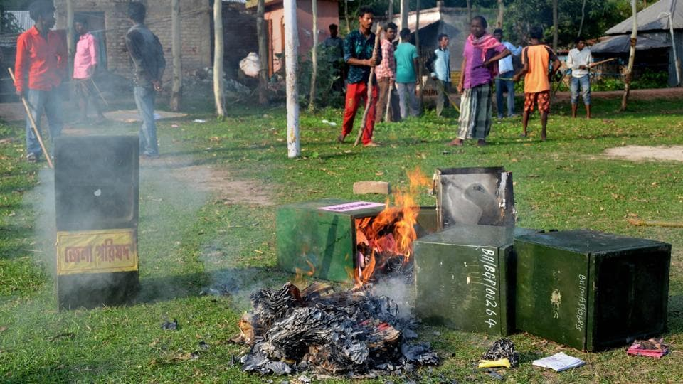 Ballot boxes being burned after mobs snatched them from a polling booth during the panchayat polls at Deotala in Malda district of West Bengal, on Monday.