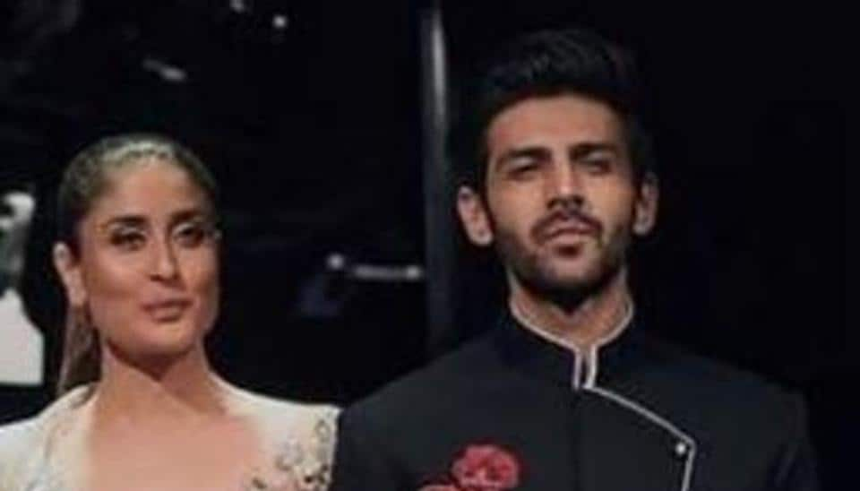 Kartik Aaryan has walked the ramp with Kareena Kapoor Khan at designer Manish Malhotra's show in Singapore.