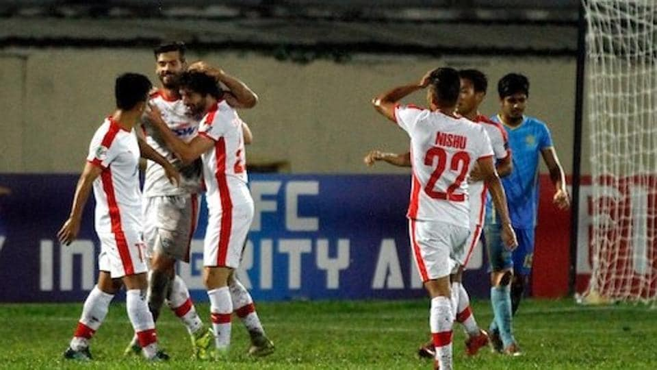Bengaluru FCplayers celebrate scoring against DbahaniDhaka in their AFCCup Group E match in Dhaka onWednesday.