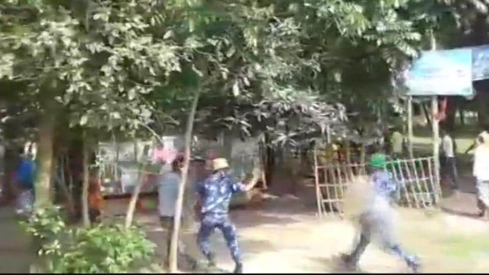 Rapid Action Force and police baton-charge voters in North Dinajpur district's Goalpokhor when they agitated due to delay in voting process.