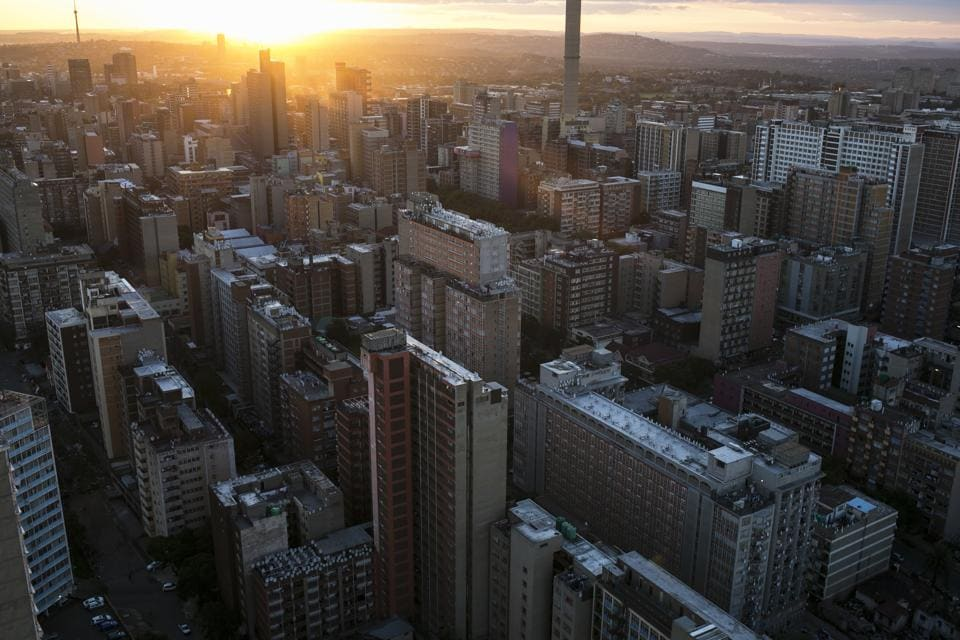 Downtown Johannesburg, South Africa. Some of Johannesburg's decaying blocks have been turned into upscale venues with art galleries and coffee shops, the first steps to restoring vibrancy to the city's downtown that many fled in the waning years of apartheid, or white minority rule, which ended in the early 1990s. (Bram Janssen / AP)
