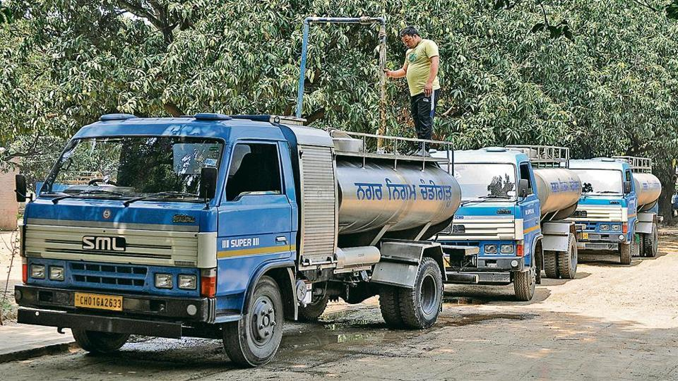 TANKERS ON A ROLL: A municipal corporation (MC) worker fills the water tankers at the Water Supply Center and complaints office, Sector 15, Chandigarh.