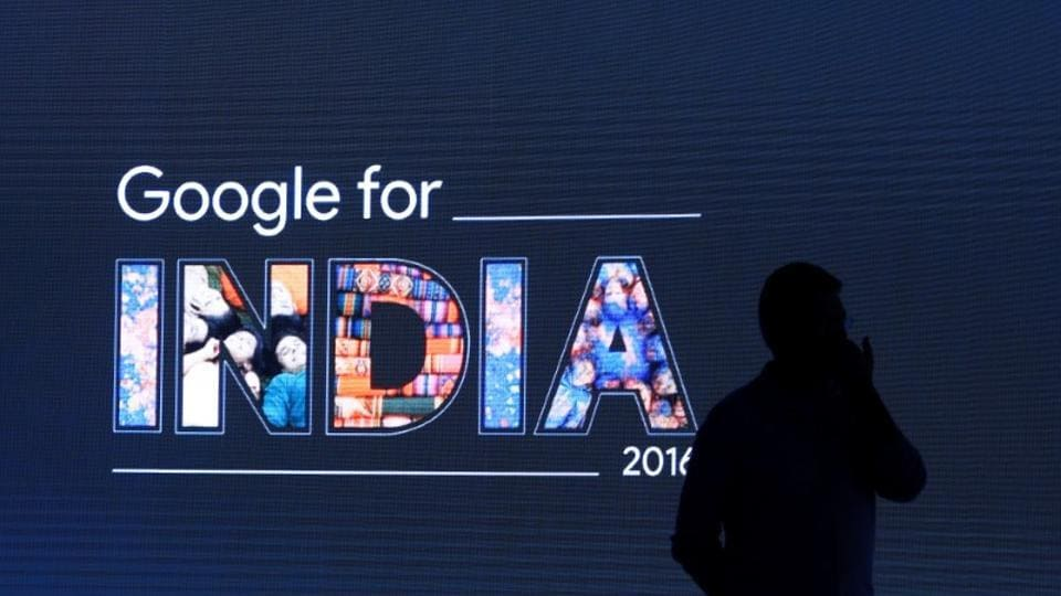 A man stands in front of a screen during a Google event in New Delhi.