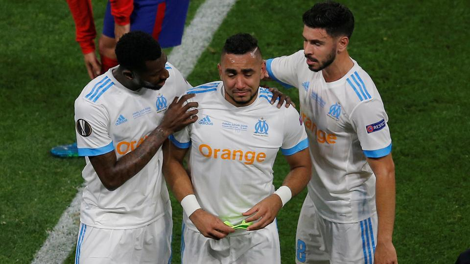 Marseille were then dealt a big blow as key playmaker Dimitri Payet (C) had to be subbed off after sustaining an injury.  (REUTERS)