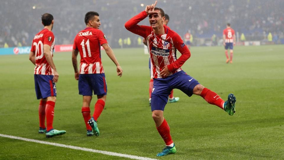 Griezmann celebrates scoring the goal that all but ended the game.  (REUTERS)