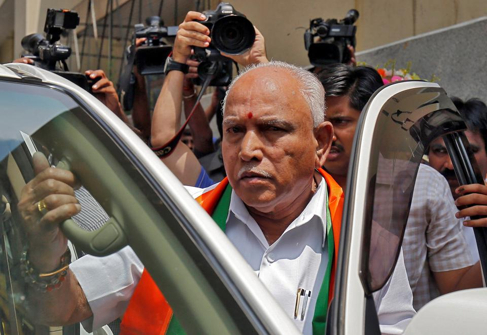 Bharatiya Janata Party (BJP) leader and former Karnataka chief minister  BS Yeddyurappa leaves to meet the state governor to stake claim to form government, in Bengaluru, on May 16, 2018.