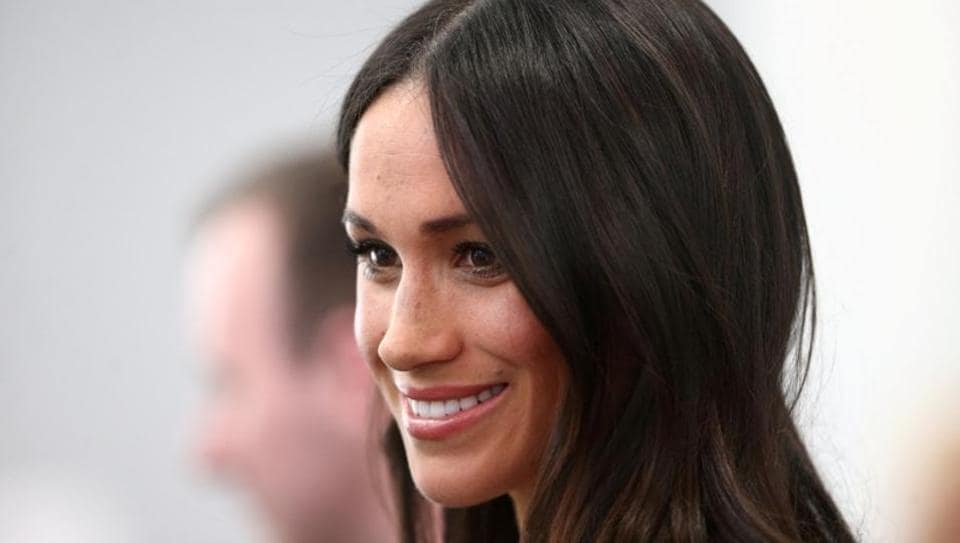 Britain's Prince Harry's fiancee Meghan Markle attends a reception with delegates from the Commonwealth Youth Forum at the Queen Elizabeth II Conference Centre, London.