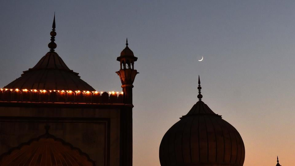 Muslim devotees break their fast on the first day of the Islamic holy month of Ramadan at Jama Masjid in Delhi.