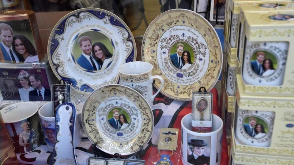 Plates, mugs and spoons are just the beginning of themed souvenirs doing the rounds for the forthcoming royal wedding. With growth shrinking and the government riven over Brexit, Saturday's wedding is set to provide a national boost and give people an excuse to party. (Toby Melville / Reuters)