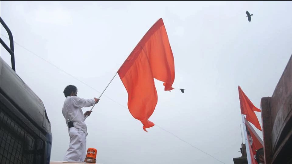 A file photo of a Shiv Sena member waving the party flag.
