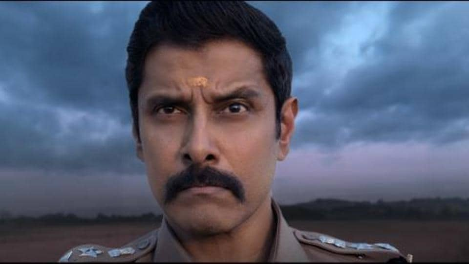 Vikram stars as a hot-headed cop Aarusaamy in Saamy Square.