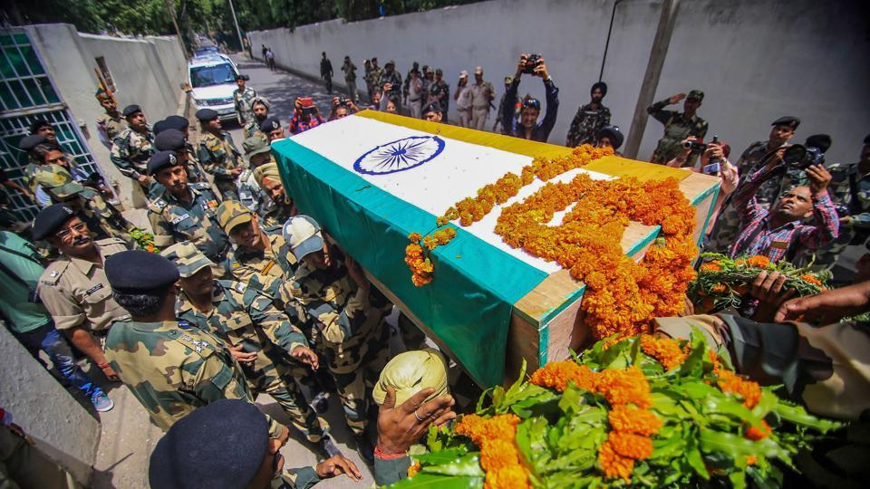 Border Security Force (BSF) personnel carry the coffin of soldier Sita Ram Upadhyaya who was killed in firing by Pakistan Rangers along the International Border. at the BSF headquarters in Jammu on Friday. Jammu and Kashmir chief minister Mehbooba Mufti hit out at Pakistan for violating ceasefire in the region, saying Islamabad has shown no respect for Ramzan. (PTI)